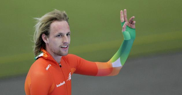 Ronald Mulder of the Netherlands celebrates after winning the men's 500m race at the speed skating World Cup in Inzell, southern Germany, Saturday, March 8, 2014