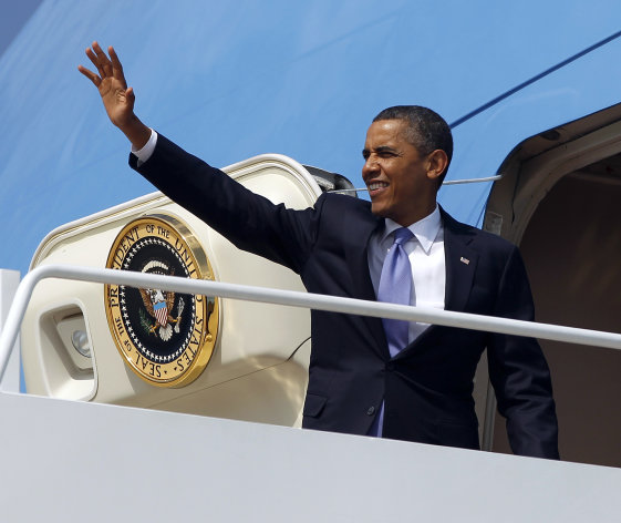 President Barack Obama waves as he boards Air Force One before his departure from Andrews Air Force Base, Md., Monday, July, 30, 2012. Obama is traveling to New York for a private fundraiser. (AP Photo/Pablo Martinez Monsivais)