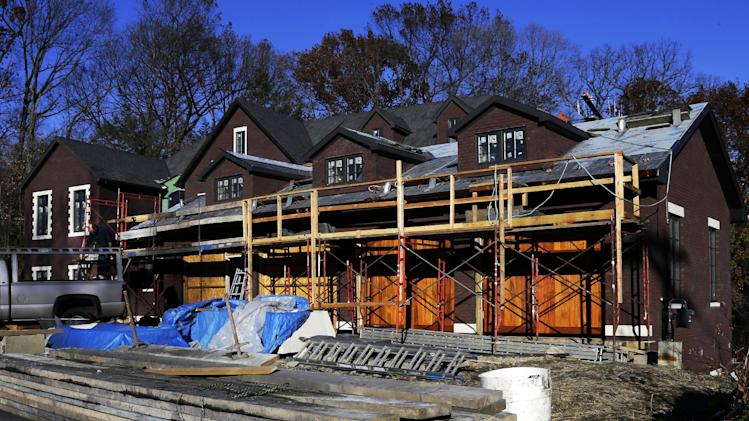 In this Thursday, Nov. 14, 2013 photo, construction continues on a new single family home in Mount Lebanon, Pa. The Commerce Department reports the pace at which builders broke ground on homes in November on Wednesday, Dec. 18, 2013. (AP Photo/Gene J. Puskar)