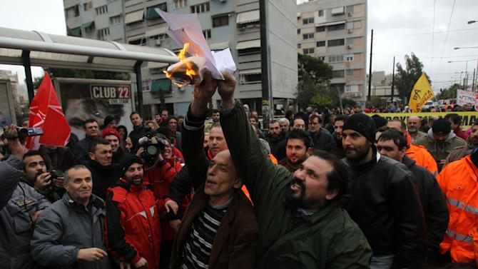 Greeks protest transport workers' pay cuts