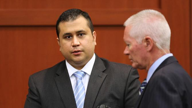 George Zimmerman, left, is escorted by court personnel during a recess on the 16th day of his trial in Seminole circuit court, in Sanford, Fla., Monday, July 1, 2013. Zimmerman has been charged with second-degree murder for the 2012 shooting death of Trayvon Martin.(AP Photo/Orlando Sentinel, Joe Burbank, Pool)
