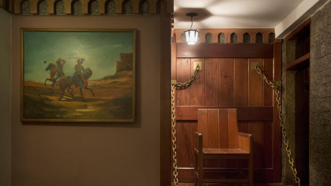 "An iron chain-strewn chair decorates the Medieval Room at the Shalimar Hotel, known as a love hotel in Rio de Janeiro, Brazil, Thursday, Jan. 17, 2013. With the arrival of next year's World Cup soccer tournament and the 2016 Olympic Games to this seaside city, local officials are scrambling to bridge a chronic hotel bed shortage so severe that during a UN conference here last year, the mayor had to appeal to residents to open their apartments to visitors. The plan? Slash property taxes for love hotels, known as ""motels"" in Portuguese, that agree to tone down the decor and free up 90 percent of their rooms for the tsunami of visitors expected to flood the city. (AP Photo/Felipe Dana)"