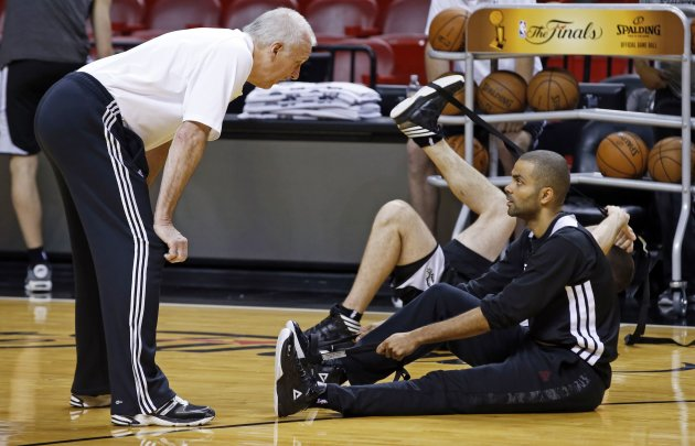 San Antonio Spurs Head Coach Popovich talks with guard Parker during a team practice ahead of Game 7 of the NBA Finals basketball playoff against the Miami Heat in Miami