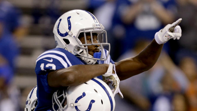 Indianapolis Colts wide receiver T.Y. Hilton, top, celebrates as he jumps into the arms of tackle Joe Reitz after scoring a touchdown against the Miami Dolphins during the second half of an NFL football game in Indianapolis, Sunday, Nov. 4, 2012. (AP Photo/Darron Cummings)