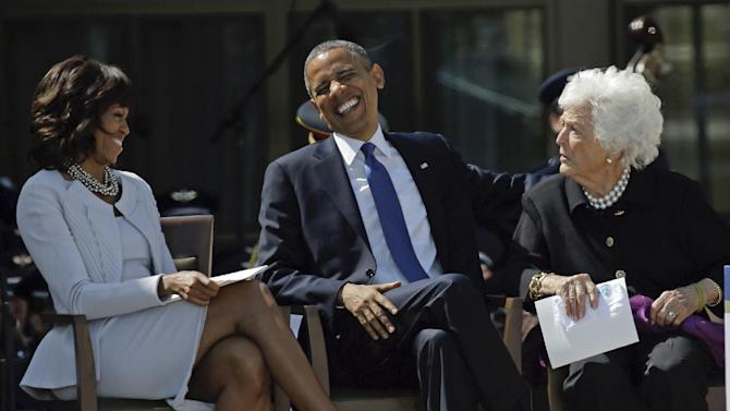 President Barack Obama laughs as he sits between his wife, first lady Michelle Obama and former first lady Barbara Bush after his speech during the dedication of the George W. Bush Presidential Center, Thursday, April 25, 2013, in Dallas. (AP Photo/David J. Phillip)