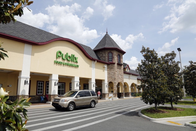 A vehicle passes the front of the Publix supermarket in Zephyrhills, Fla., Sunday, May 19, 2013. The highest Powerball jackpot worth an estimated $590.5 million was sold recently at this Publix superm