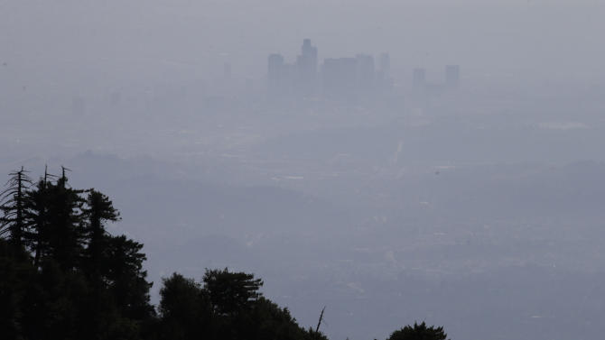 This April 15,2013 photo shows the hazy skyline of Los Angeles seen from Mount Wilson, Calif., Monday, April 15, 2013. A mile above this city, sensors gaze down on the basin from atop Mount Wilson the way a satellite fixates on Earth, collecting pieces of information about Los Angeles' carbon footprint. (AP Photo/Jae C. Hong)