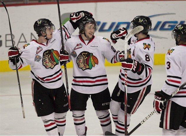 Portland Winterhawks center Brendan Leipsic is congratulated by teammates after scoring a tying goal against the Edmonton Oil Kings in the third period during Game 5 of the Western Hockey League final