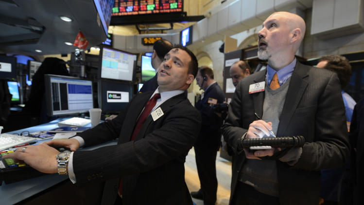 Paul Cosentino, left, of Goldman Sachs and Patrick Armstrong of Prime Executions work on the floor of the New York Stock Exchange, Wednesday, Feb. 13, 2013 in New York. (AP Photo/Henny Ray Abrams)