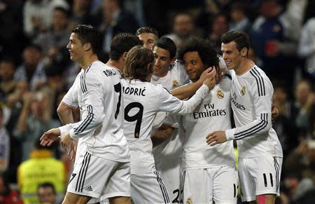 Real Madrid's Marcelo is congratulated by teammates after scoring against Levante during their Spanish first division soccer match in Madrid