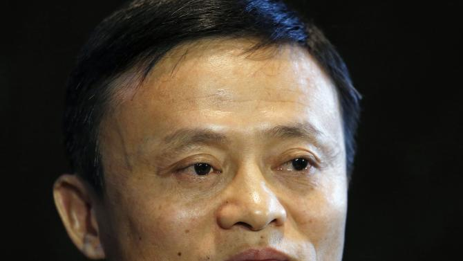 Alibaba Executive Chairman Jack Ma looks on as he meets journalists ahead of an IPO roadshow, inside a hotel in Hong Kong