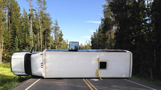 This Thursday, July 10, 2014 photo provided by the Grand Teton National Park shows a bus that flipped on its side in Grand Teton National Park. Officials say about two dozen people were taken to a hospital after a bus flipped on its side. Authorities say no other vehicles were involved. It wasn't clear who owned the bus or whether it was on a tour. (AP Photo/Michael Nash, Grand Teton National Park)