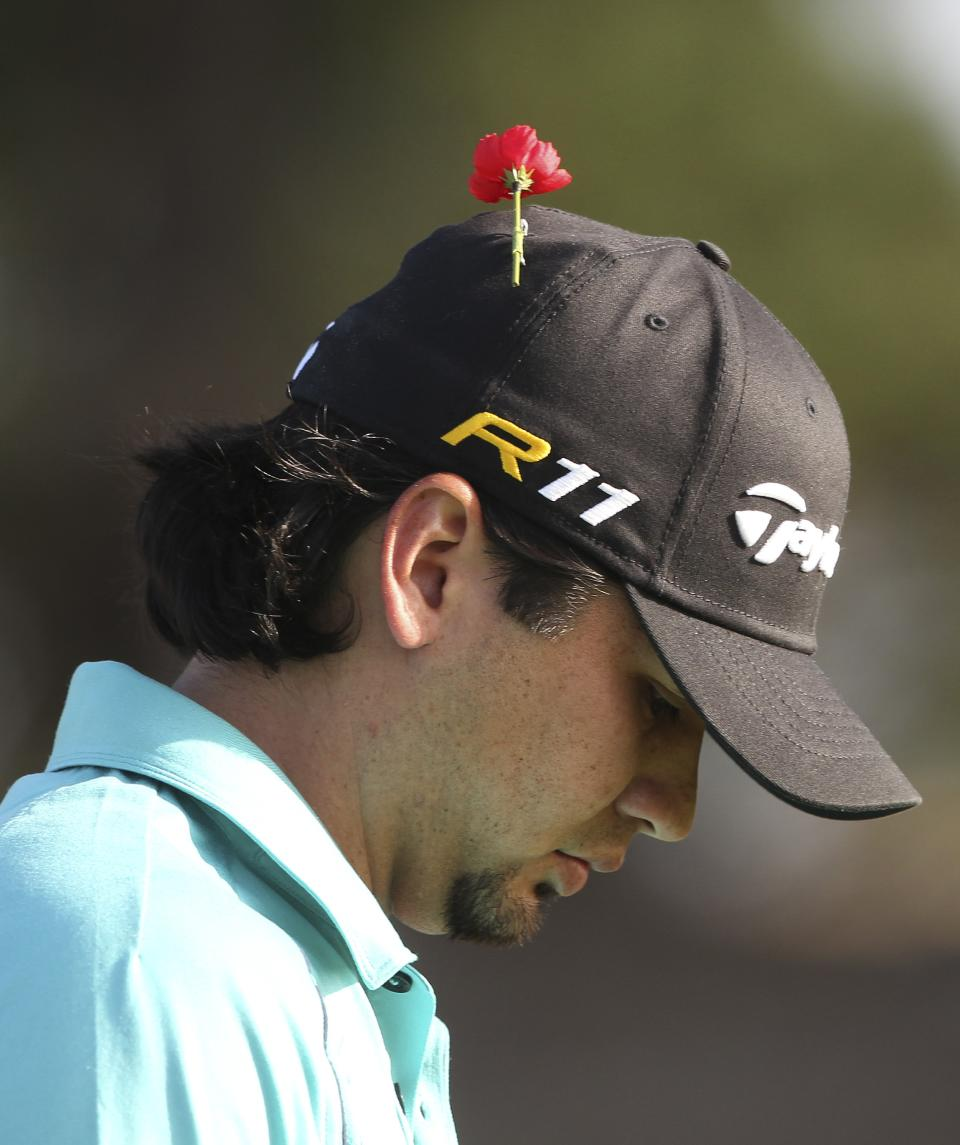 Australian golfer Jason Day wears a Remembrance Day poppy atop his cap during the second round of the Australian Open golf tournament in Sydney, Australia, Friday, Nov. 11, 2011. Remembrance Day honors British Commonwealth forces who died on duty. (AP Photo/Rob Griffith)