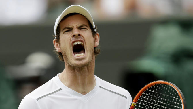 Andy Murray of Britain reacts during his match against Robin Haase of the Netherlands at the Wimbledon Tennis Championships in London