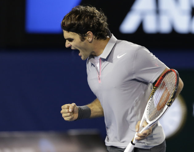 Switzerland's Roger Federer reacts after winning the second set of his men's semifinal against Britain's Andy Murray at the Australian Open tennis championship in Melbourne, Australia, Friday, Jan. 25