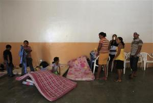 Family gathers at a school being used as a shelter …