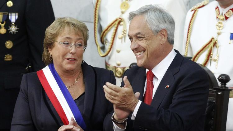 Chile's President Michelle Bachelet and outgoing President Sebastian Pinera applaud after Bachelet was sworn in to office in Valparaiso
