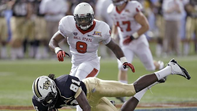 Central Florida wide receiver Breshad Perriman (81) is tripped up by Ball State linebacker Travis Freeman (8) after a reception during the first quarter of the Beef 'O' Brady's Bowl NCAA college football game Friday, Dec. 21, 2012, in St Petersburg, Fla. (AP Photo/Chris O'Meara)