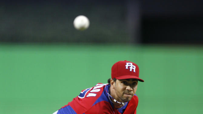 Puerto Rico's Nelson Figueroa delivers a pitch during the first inning of the second round elimination game of the World Baseball Classic against the United States, Friday, March 15, 2013 in Miami. (AP Photo/Andrew Innerarity, Pool)