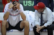 American John Isner (L) reacts next to his team captain Jim Courier after the second match of the Davis Cup semi-final against Spain at the Hermanos Castro park court in Gijon, northern Spain. Almagro won 6-4, 4-6, 6-4, 3-6, 7-5