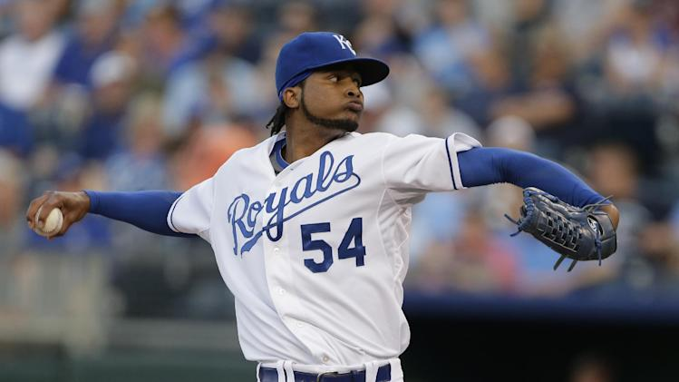 In this Aug. 20, 2013 file photo, Kansas City Royals starting pitcher Ervin Santana throws during the first inning of a baseball game against the Chicago White Sox, in Kansas City, Mo. The Atlanta Braves have signed Santana to bolster their injury plagued starting rotation. The team announced Wednesday, March 12, 2014, that Santana agreed to a one-year deal