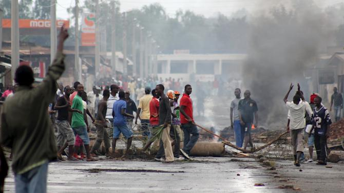 Protesters erect a barricade during demonstrations in Burundi's capital Bujumbura