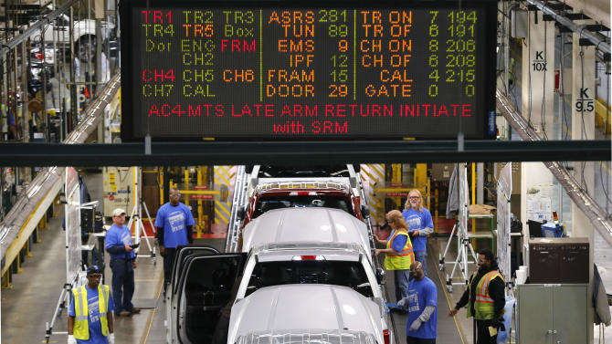 FILE - In this Nov. 11, 2014 file photo, 2015 Ford F-150s move along the production line at the Dearborn Truck Plant in Dearborn, Mich. Auto sales are on track to increase 6 percent this year with 16.5 million new vehicles on the road, according to Cars.com. (AP Photo/Paul Sancya, File)