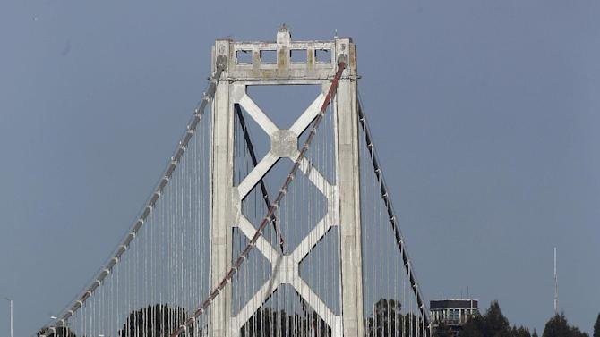 Workers inspect damage to the bottom of a tower on the San Francisco-Oakland Bay Bridge in San Francisco, Monday, Jan. 7, 2013. An empty oil tanker ship, Overseas Reymar, struck the San Francisco-Oakland Bay Bridge on Monday, but there were no reports of leaking oil and the bridge remained open to traffic, officials said. (AP Photo/Jeff Chiu)