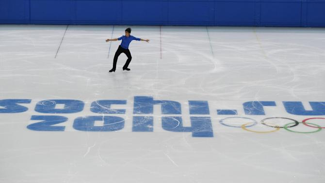 Michael Christian Martinez from the Philippines trains in the Iceberg Skating Palace in preparation for the men's figure skating competition the 2014 Winter Olympics, Thursday, Jan. 30, 2014, in Sochi, Russia