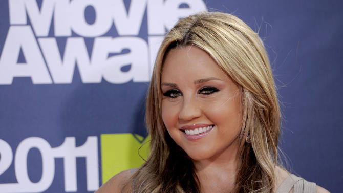 FILE - In this June 5, 2011 file photo, Amanda Bynes arrives at the MTV Movie Awards, in Los Angeles. An attorney for Bynes' mother said Thursday, Dec. 5, 2013, that the actress has been released from an inpatient treatment facility and is now with living with her parents. Bynes had been involuntarily committed earlier this year after authorities detained her for starting a fire in a woman's driveway in Ventura County, Calif. (AP Photo/Chris Pizzello, File)