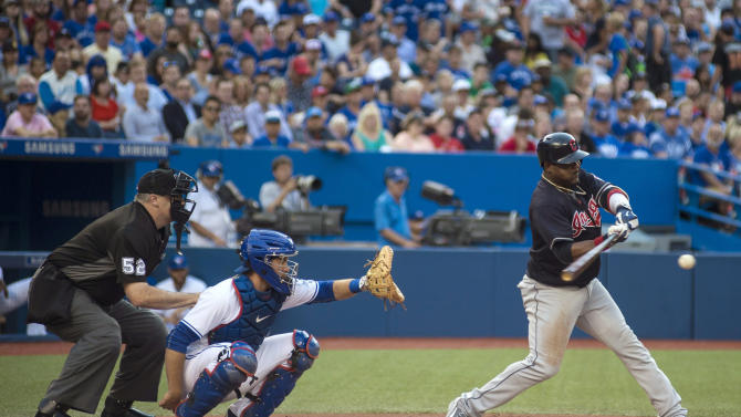 Cleveland Indians' Juan Uribe swings at a pitch during the second inning of a baseball game against the Toronto Blue Jays on Thursday, June 30, 2016, in Toronto. Uribe singled on the at-bat. (Eduardo Lima/The Canadian Press via AP)