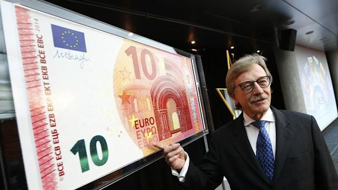 Yves Mersch, Member of the Executive Board of the European Central Bank presents an oversized newly unveiled 10 euro note at the headquarters of the European Central Bank (ECB) in Frankfurt