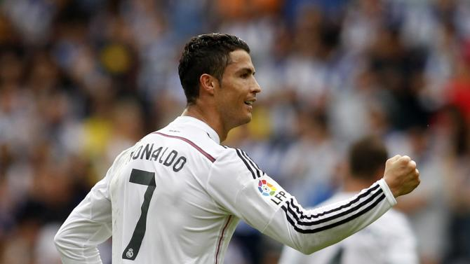 Real Madrid's Ronaldo celebrates his goal against Deportivo Coruna during their Spanish First Division soccer match at the Riazor stadium in Coruna