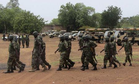 Soldiers from Lagos, part of an expected 1,000 reinforcements sent to Adamawa state to fight Boko Haram Islamists, walk near trucks as they arrive with the 23rd Armoured Brigade in Yola