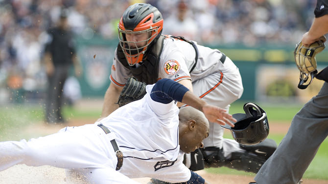Detroit Tigers' Austin Jackson, bottom, is tagged out at home plate by Baltimore Orioles catcher Craig Tatum while trying to score from first base on a throwing error by Orioles third baseman Chris Davis in the first inning of a baseball game on Sunday, Sept. 25, 2011, at Comerica Park in Detroit. (AP Photo/Lon Horwedel)