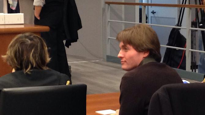 In this picture taken with a mobile phone, US student Amanda Knox's Italian ex-boyfriend Raffaele Sollecito, right, sits with his lawyer Giulia Bongiorno, ahead of a hearing in Sollecito and Knox's trial at an appeals court in Florence, Italy, Wednesday, Nov. 6, 2013. Sollecito has arrived at a Florence appeals court to make a statement in the pair's third murder trial over the death of her British roommate Meredith Kercher. Knox and Sollecito's 2009 conviction of murdering Kercher was overturned on appeal in 2011, freeing her to return to the United States. But Italy's highest court ordered a fresh appeals trial, blasting the acquittal as full of contradictions. Knox has not returned to Italy for the latest trial. (AP Photo/Riccardo Sanesi, Lapresse) ITALY OUT
