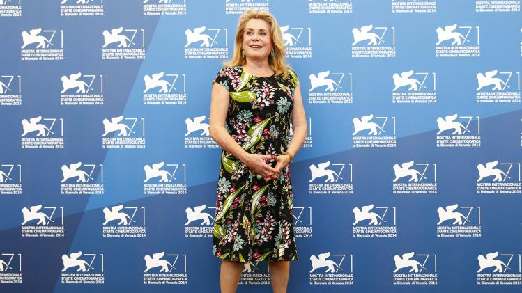 "Actress Deneuve poses during the photo call for the movie ""3 Coeurs"" at the 71st Venice Film Festival"