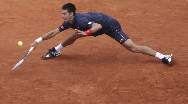 Novak Djokovic of Serbia returns in the mens final match against Rafael Nadal of Spain at the French Open tennis tournament in Roland Garros stadium in Paris, Sunday June 10, 2012. (AP Photo/David Vin