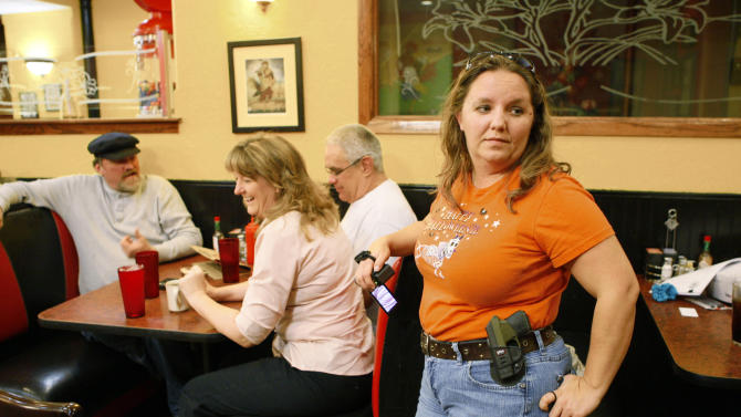 Meritt joins other members of the OKOCA wearing unconcealed side arms as they gather at Beverly's Pancake House in Oklahoma City