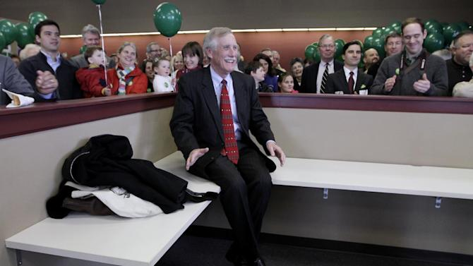 In this photo taken April 9, 2012, Angus King, Independent candidate for the U. S. Senate, sits surrounded by supporters as he's introduced at the opening of his campaign office in Brunswick, Maine. King of Maine has a woman problem. He's not one. The popular former governor is the undisputed front-runner in the campaign to replace retiring Republican Sen. Olympia Snowe, the state's most powerful female voice in a generation. But beneath the 68-year-old businessman's popularity is a stark political reality: For many Maine women, King is not their first choice. And this election, perhaps more than any other, underscores the sometimes conflicting priorities for a Democratic Party struggling to beat back a Republican takeover of the Senate. (AP Photo/Pat Wellenbach)