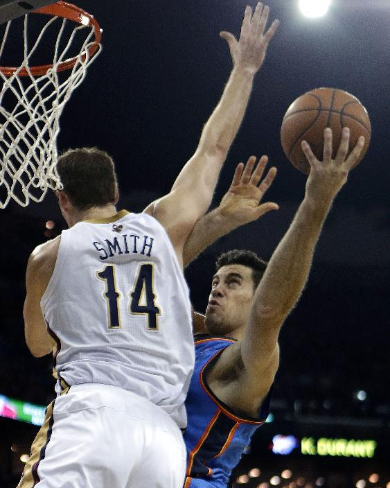 Oklahoma City Thunder power forward Nick Collison, right, shoots against New Orleans Pelicans center Jason Smith (14) in the first half of an NBA basketball game in New Orleans, Friday, Dec. 6, 2013