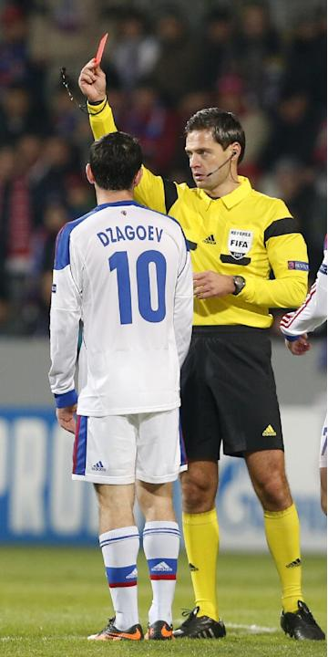 Slovenia's referee Damir Skomina shows a red card to Moscow's Alan Dzagoev during the Champions League Group D soccer match between Viktoria Pilsen and CSKA Moscow in Pilsen, Czech Republic, T