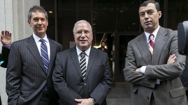 Defense attorneys, from left, Ronald Kaye, Stanley Friedman, and Shepard Kopp comment on their clients, after a judge declared a mistrial Thursday on dozens of remaining counts against five former city of Bell elected officials accused of misappropriating public funds, in Los Angeles Thursday, March 21, 2013. Jurors had reached mixed verdicts on Wednesday, convicting the former mayor and four former Bell City Council members of 21 counts of misappropriating public funds and acquitting them of 21 other counts. (AP Photo/Damian Dovarganes)