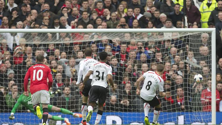Liverpool's Steven Gerrard, right, scores his side's first goal against Manchester United during their English Premier League soccer match at Old Trafford Stadium, Manchester, England, Sunday March 16, 2014. (AP Photo/Jon Super)