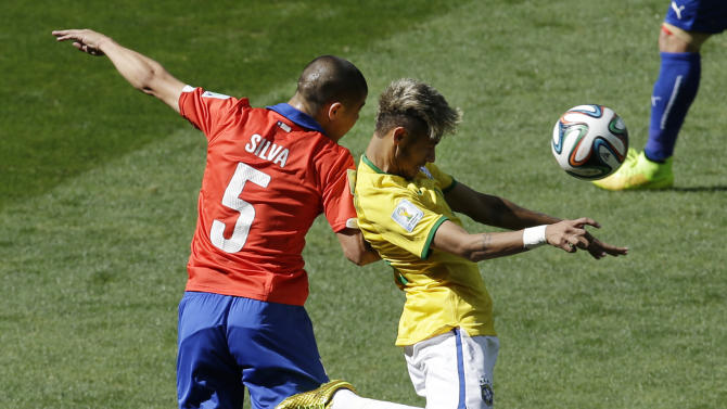 Chile's Francisco Silva, left, and Brazil's Neymar go for a header during the World Cup round of 16 soccer match between Brazil and Chile at the Mineirao Stadium in Belo Horizonte, Brazil, Saturday, June 28, 2014