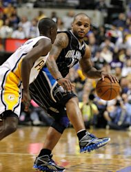 INDIANAPOLIS, IN - APRIL 28: Jameer Nelson #14 of the Orlando Magic looks to get around the defense of Darren Collison #2 of the Indiana Pacers in Game One of the Eastern Conference Quarterfinals during the 2012 NBA Playoffs on April 28, 2012 at Bankers Life Fieldhouse in Indianapolis, Indiana. Orlando won the game 81-77 to take a 1-0 series lead. (Photo by Gregory Shamus/Getty Images)