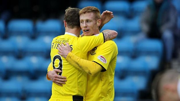Eoin Doyle, right, secured a point for Hibs away at Kilmarnock