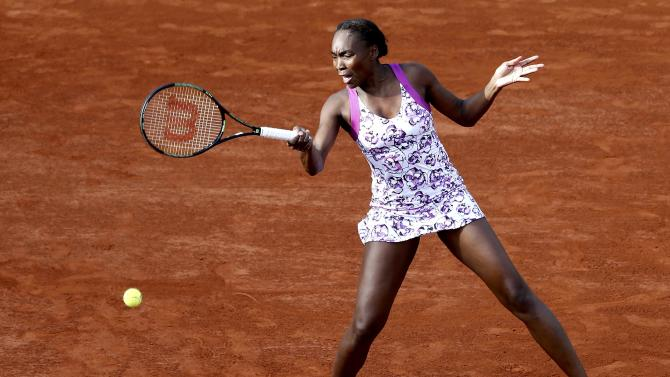 Venus Williams of the the U.S. plays a shot to compatriot Sloane Stephens during their women's singles match at the French Open tennis tournament at the Roland Garros stadium in Paris