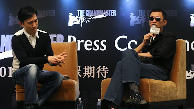 "Movie director Wong Kar-wai, right, speaks while actor Tony Leung listens during a press conference on Wednesday, Jan. 23, 2013 in Singapore. For a director and actor who have worked together for about two decades, there did not seem to be much chemistry between Wong and Leung at the news conference promoting their new movie ""The Grandmaster."" (AP Photo/Wong Maye-E)"