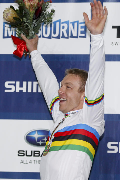 Sir Chris Hoy reacts on the podium for the Keirin at the 2012 Track Cycling World Championships in Melbourne, on April 8, 2012.  IMAGE STRICTLY RESTRICTED TO EDITORIAL USE - STRICTLY NO COMMERCIAL USE
